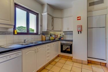 Kitchen in Pine Cliffs Apartment